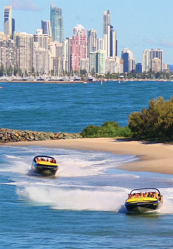 Two Jet Boats Racing along the beach